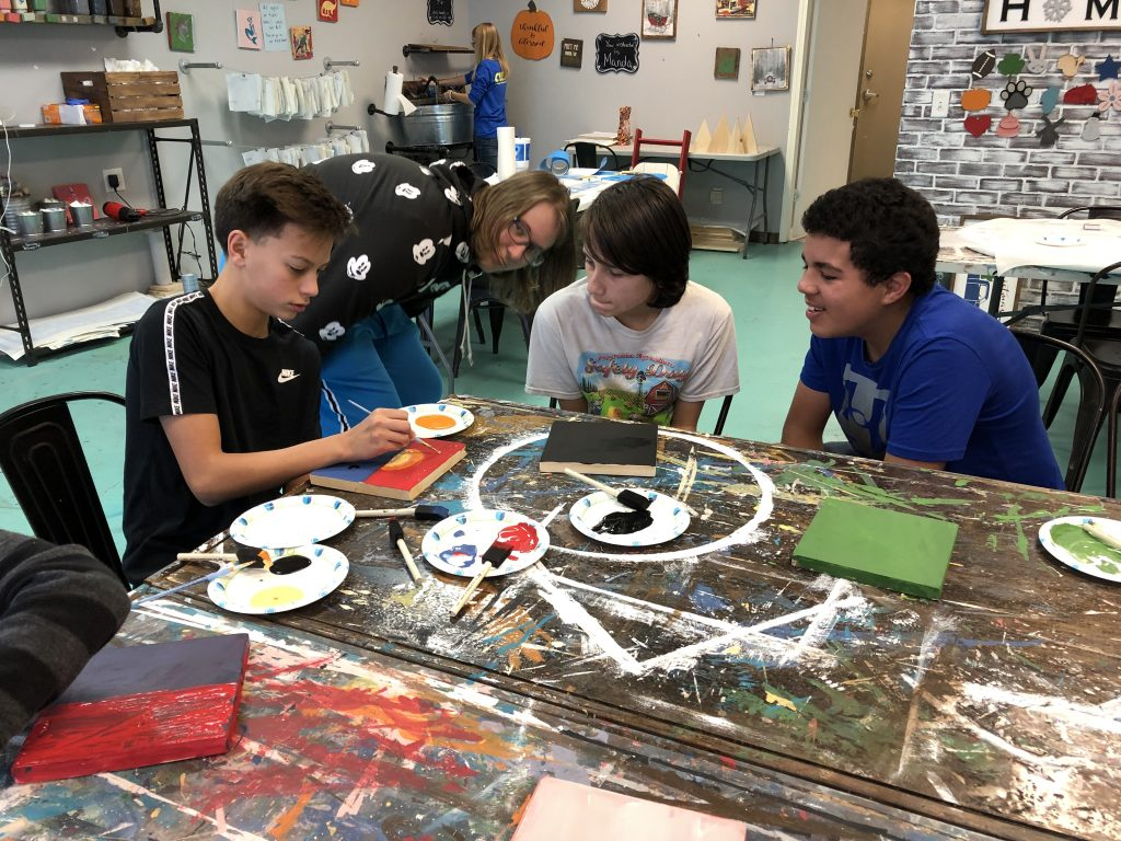 youth at painting studio